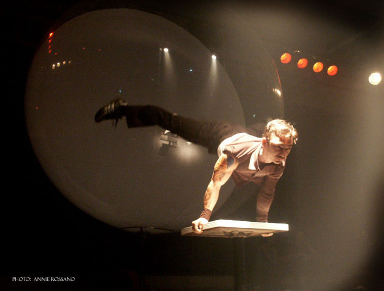 Circus acrobat doing a planche