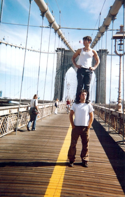 Acrobats travelling to New York doing tricks on the Brooklyn Bridge