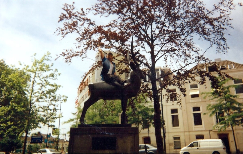 Acrobat riding a deer statue in Arnhem, Holland