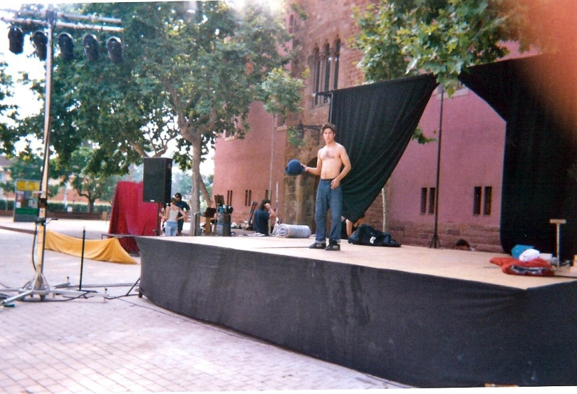 Circus acrobat on stage at a street performing festival in Spain