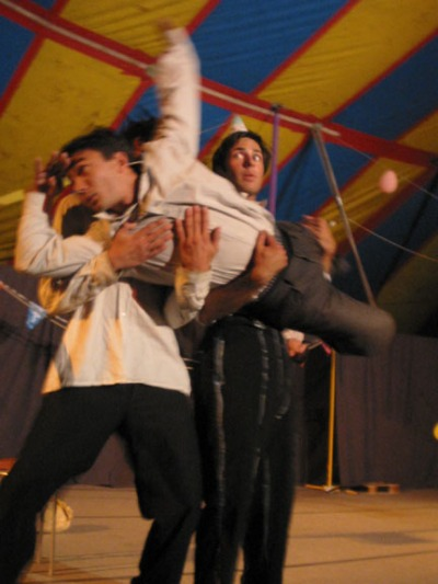 Circus acrobats doing a streetshow under a big top in France