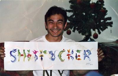 Acrobat holding a New York City souvenier