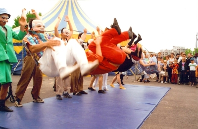 Circus acrobats doing a tumbling trick at the National Circus School exterior show
