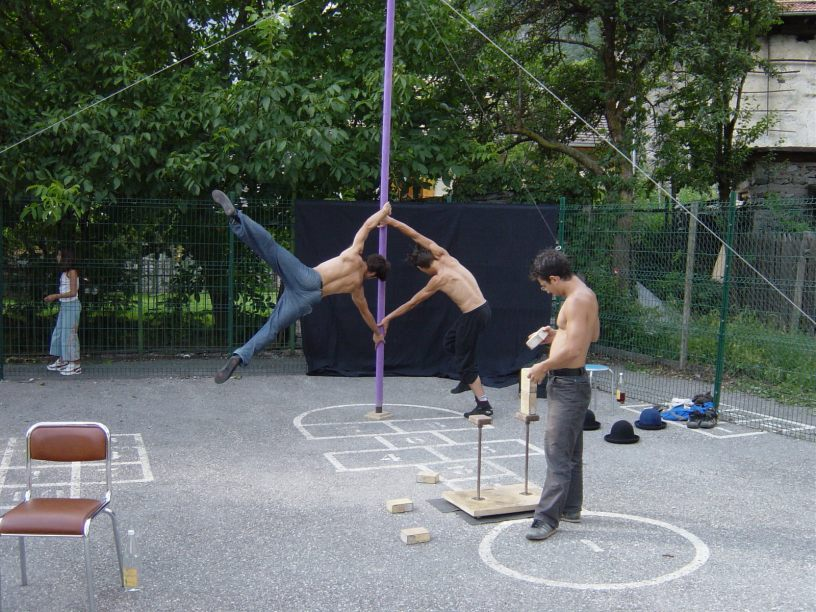 Acrobats setting up for a circus street show in France