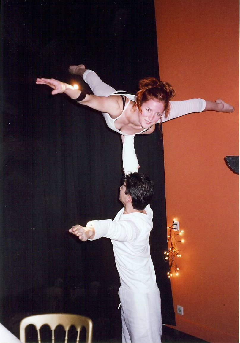 "Two acrobats performing as part of ""Til Tomorrow"" during a special event in Holland"