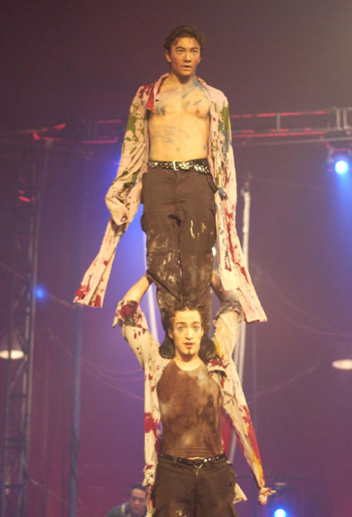 Circus acrobats doing a two-high column in the annual show of the National Circus School
