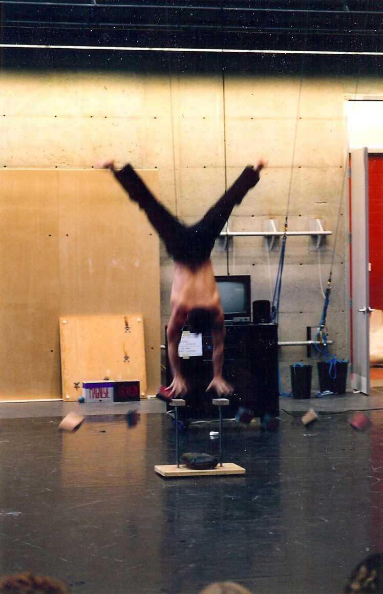 Circus acrobat doing a handstand trick at the National Circus School of Montreal