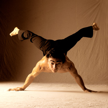 Circus acrobat in a planche